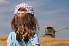 Girl looking at harvester Royalty Free Stock Images