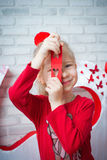 Girl looking through heart-shape Stock Photography