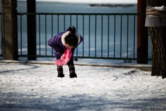 A girl looking at her shoes on snow Stock Images