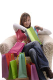 Girl looking in her shopping bags Royalty Free Stock Photography