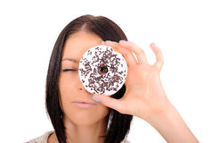 Girl looking through a hole in a donut Royalty Free Stock Photos