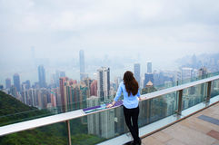Girl looking at the Hong Kong panorama Stock Photo