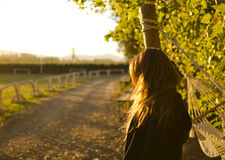 Girl looking at the horizon. Girl is looking at the horizon with a beautiful sunlight Royalty Free Stock Image