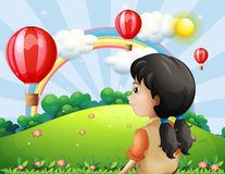 A girl looking at the hot air balloon Stock Photos