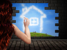 Girl looking at house of clouds Stock Photo