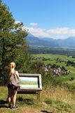 Girl looking at information board and view Straza Stock Photography