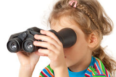 A girl looking through inverted binocular Royalty Free Stock Photo