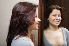 The girl looking at itself in a mirror Royalty Free Stock Image