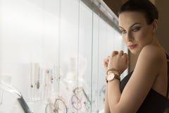Girl looking jewel indoor . shot in ambient ligh Stock Image
