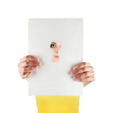 Girl looking through a keyhole Royalty Free Stock Image