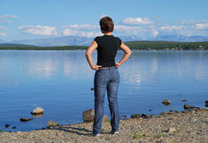 Girl, looking at a lake Stock Photos