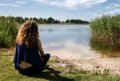 Girl Looking at Lake Stock Photo