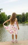 Girl looking at the lake Stock Image