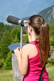 Girl looking at landscape a Stock Images
