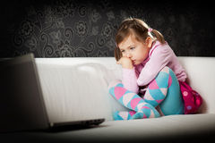 Girl looking at laptop screen Royalty Free Stock Photo