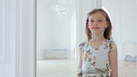 Girl looking in the large mirror stock video footage