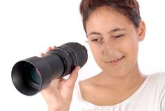 Girl looking through lens Stock Images