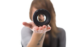 Girl looking through lens Royalty Free Stock Photos