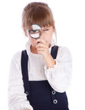 A girl is looking through the loupe Royalty Free Stock Photography
