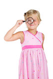 Girl looking through magnifying glass Royalty Free Stock Photo