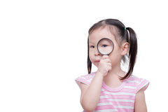 Girl looking through magnifying glass Stock Image