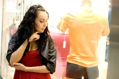 Girl looking at mannequin Royalty Free Stock Photo