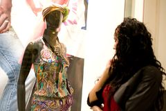 Girl looking at mannequin Royalty Free Stock Photography