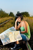 Girl looking on the map Royalty Free Stock Photo