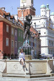 Girl looking at the map sitting by the fountain at the main squa. Re Rynek of Poznan, Poland Stock Photography