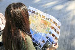 Girl looking a map in the street royalty free stock images