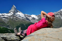 Girl looking at the Matterhorn Stock Images