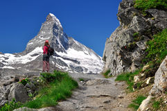 Girl looking at the Matterhorn Stock Photos
