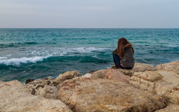 Girl looking at Mediterranean sea in Tel Aviv Stock Image