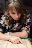 Girl looking at menu Royalty Free Stock Photo