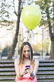 Girl looking mesage on phone, happiness connecting people concep Royalty Free Stock Photo