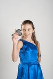 Girl looking into mirror. Girl in blue dress looking in mirror at studio royalty free stock photo
