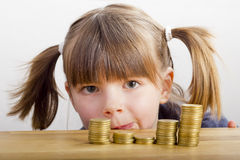 Girl looking at money Stock Photo