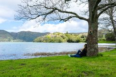 Girl looking over Sete Cidades lake into the mountains, Azores, Portugal royalty free stock images