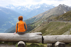 Girl looking at the mountains Stock Image