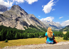 Girl looking at mountains Royalty Free Stock Photos