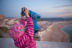Girl looking at Nazare Stock Photo