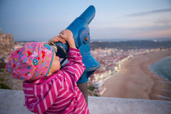 Girl looking at Nazare Royalty Free Stock Photography