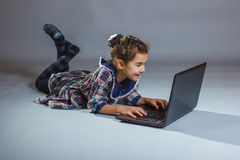 Girl looking netbook and experiencing the joy on a Stock Images