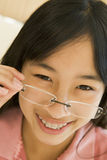 Girl Looking Through New Glasses Royalty Free Stock Images