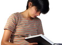 Girl looking in a notebook Royalty Free Stock Image
