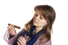Girl looking at one cigar Stock Image