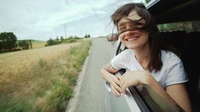 Girl looking out of backseat window stock footage