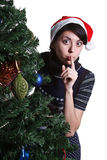 Girl looking out christmas tree Royalty Free Stock Photos