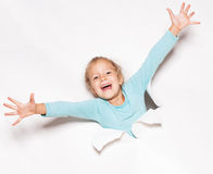Girl looking out of a hole in paper. Child looking out of a hole. Banner. Happy girl stock photo