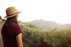 Girl looking out over the mountain Royalty Free Stock Photography